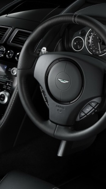 aston_martin_db9_2010_black_salon_interior_steering_wheel_speedometer_23890_1080x1920